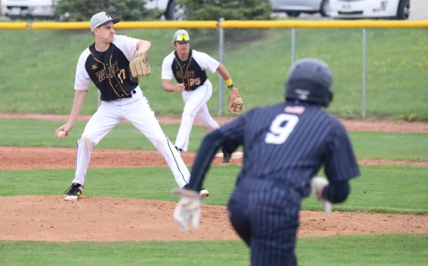 Valley sophomore pitcher Cooper Foster prepares to throw a pitch, while University's Kanon Padilla looks to advance to home during the Bulldogs' 10-0 win on Saturday, May 15 in Greeley. (Courtesy/Brian Stotts)