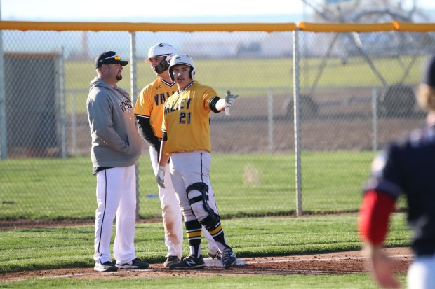Valley coach Steve Kissler, left, senior Ty Stotts, center, and senior Brandon Blanco converse during the Vikings' 8-2 Class 3A baseball win against Liberty Common on May 4, 2021. (Courtesy/Brian Stotts)