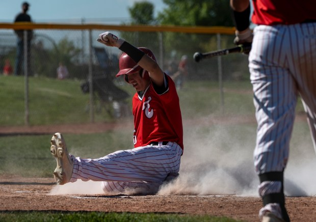 GREELEY, CO - MAY 27:Eaton's Hayden Vigueria (6) slides into home plate during the Eaton Reds baseball gamer against the University Bulldogs at University High School in Greeley May 27, 2021. The Reds defeated the Bulldogs 12-5. (Alex McIntyre/Staff Photographer)