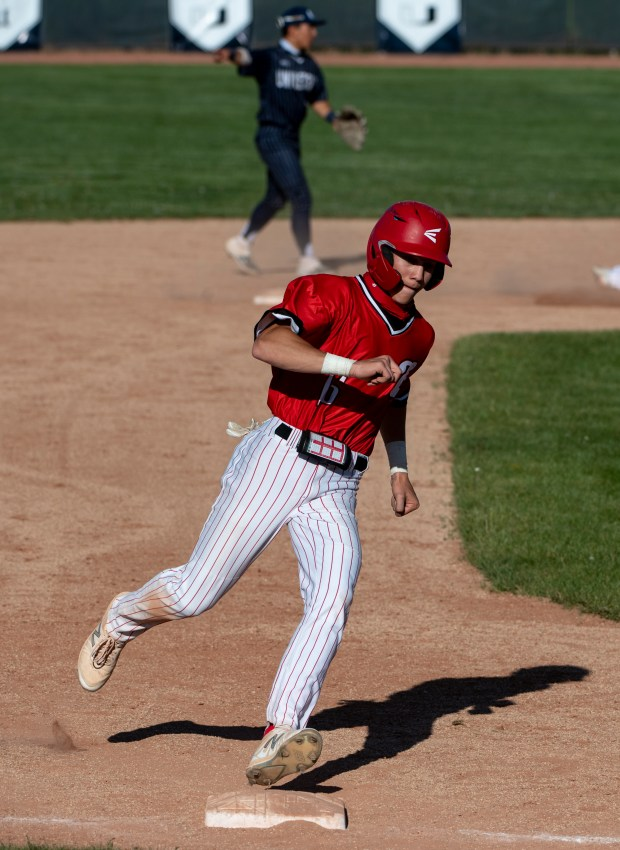 GREELEY, CO - MAY 27:Eaton's Walker Martin (16) rounds third base during the Eaton Reds baseball game against the University Bulldogs at University High School in Greeley May 27, 2021. The Reds defeated the Bulldogs 12-5. (Alex McIntyre/Staff Photographer)