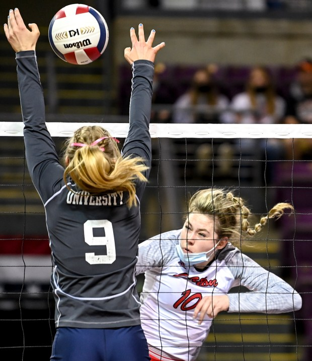 COLORADO SPRINGS, CO - MAY 13:Eaton's Sydney Leffler (10) attacks as University's Paige Heck (9) leaps to block during the Eaton Reds 3A girls volleyball state semifinal match against the University Bulldogs at The Broadmoor World Arena in Colorado Springs May 13, 2021.(Alex McIntyre/Staff Photographer)