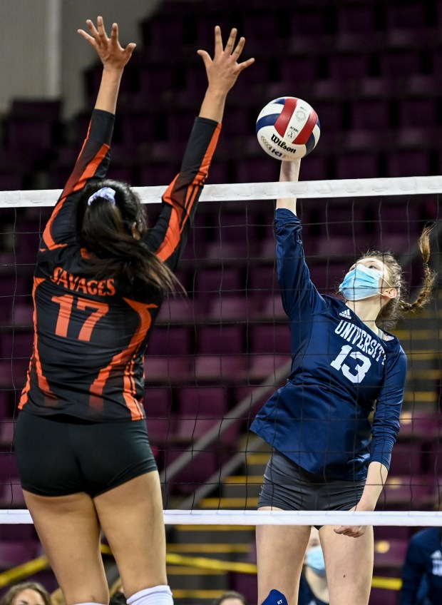 COLORADO SPRINGS, CO - MAY 12:University's Katie Bauer (13) attacks as Lamar's Fernanda Merancio (17) leaps to block during the University Bulldogs 3A girls volleyball state quarterfinal match against the Lamar Savages at The Broadmoor World Arena in Colorado Springs May 12, 2021. The University Bulldogs defeated the Lamar Savages 3-1 and will advance to the semifinals. (Alex McIntyre/Staff Photographer)