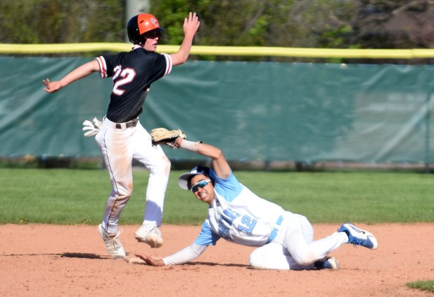 GREELEY, CO - MAY 12:Greeley West's Nolan Hydock tries to pick off Greeley Central's Reid Richardson during the game at Butch Butler Field in Greeley May 12, 2021. (Photos by Josh Polson/For the Greeley Tribune)