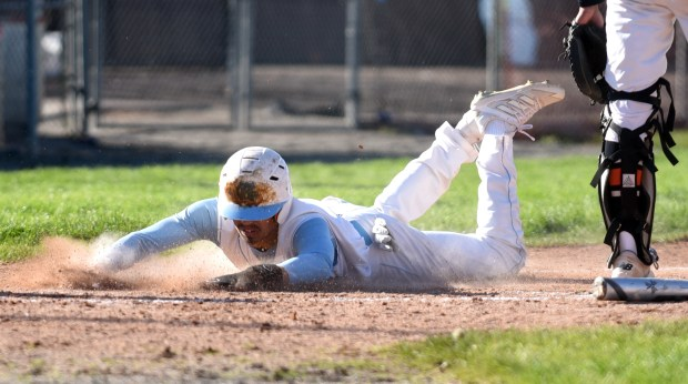 GREELEY, CO - MAY 12:Greeley West's Gio Munoz slides into home plate during the game against Greeley Central at Butch Butler Field in Greeley May 12, 2021. (Photos by Josh Polson/For the Greeley Tribune)