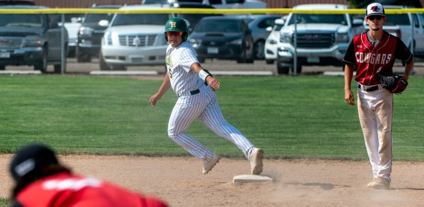 AULT, CO - JUNE 15:Highland's Mark Banuelos (6) looks back as he rounds second base during the Highland Huskies regional baseball game against the Burlington Cougars at Highland High School in Ault June 15, 2021. The Huskies defeated the Cougars 13-5. (Alex McIntyre/Staff Photographer)