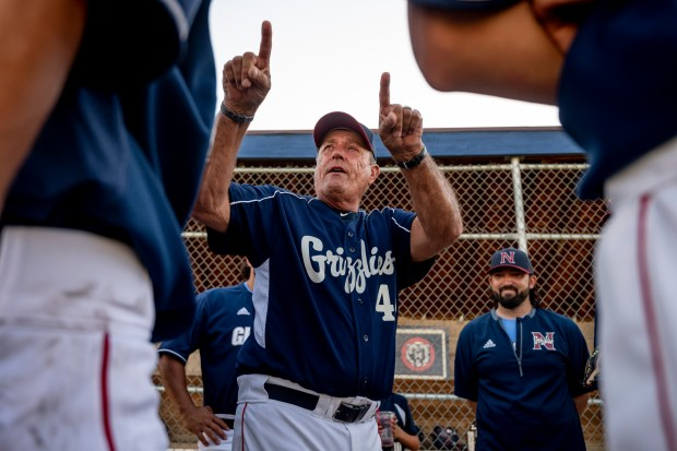 GREELEY, CO - JUNE 10:Northridge head coach Mike Huston speaks to his team after the Northridge Grizzlies won their baseball game against the Silver Creek Raptors at Darryl Kile Field in Greeley June 10, 2021. The Grizzlies defeated the Raptors 9-7. (Alex McIntyre/Staff Photographer)