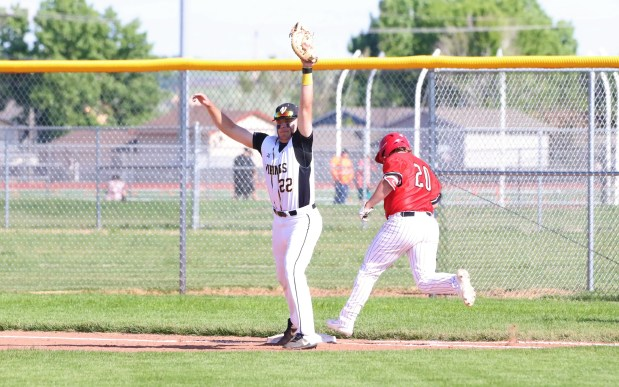 Valley senior Ty Stotts, left, attempts to put out Eaton junior Dirk Duncan during the Reds' 15-1 win in a Class 3A Patriot League baseball game Wednesday, June 2, in Gilcrest. (Courtesy/Brian Stotts)