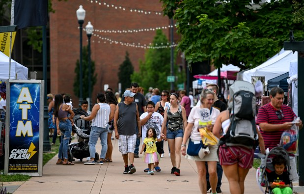 GREELEY, CO - JULY 24:People walk down a row of vendor booths during the 2021 Greeley Arts Picnic at Lincoln Park in downtown Greeley July 24, 2021. The event, canceled in 2020 due to the COVID-19 pandemic, features artists, food and drink vendors, performances for adults and kids and more. (Alex McIntyre/Staff Photographer)