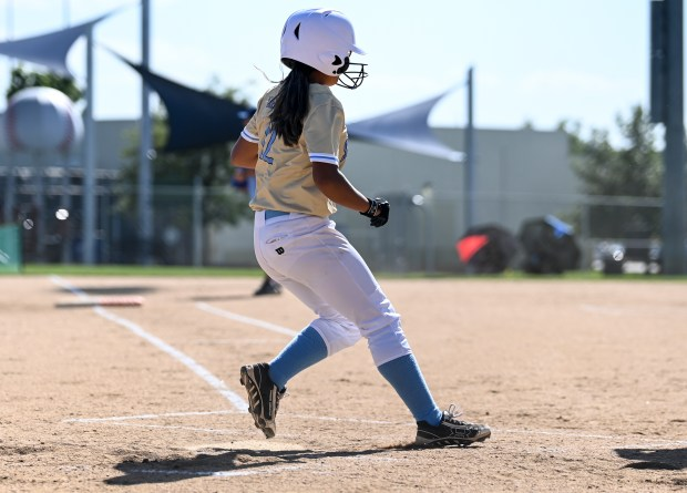 GREELEY, CO - AUGUST 24:Greeley West's Esmerelda Perez (12) runs home during the Greeley Central Wildcats softball game against the Greeley West Spartans at the Greeley-Evans Youth Sports Complex in Greeley Aug. 24, 2021. (Alex McIntyre/Staff Photographer)