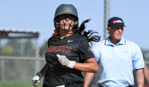 GREELEY, CO - AUGUST 24:Greeley Central's Alanna Reyna (8) looks over her shoulder as she runs home during the Greeley Central Wildcats softball game against the Greeley West Spartans at the Greeley-Evans Youth Sports Complex in Greeley Aug. 24, 2021. (Alex McIntyre/Staff Photographer)