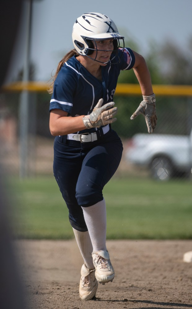 GREELEY, CO - AUGUST 12:Northridge outfielder Kennedy Strausheim (19) runs to third during the Northridge Grizzlies softball game against the Greeley West Spartans at District 6 Softball Field in Greeley Aug. 12, 2021. The Grizzlies defeated the Spartans 12-0 in four innings. (Alex McIntyre/Staff Photographer)