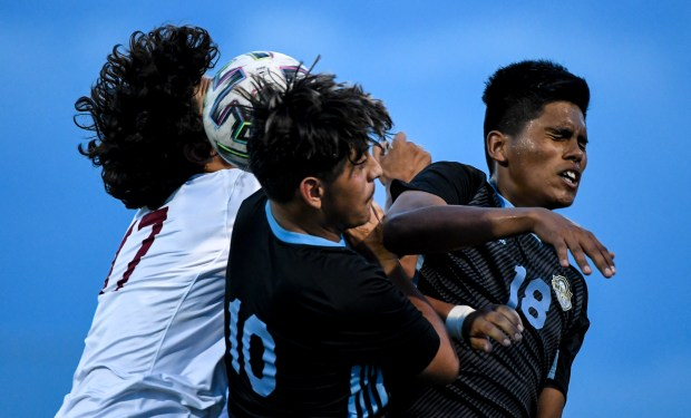 GREELEY, CO - AUGUST 26:Northridge's Julian Gordo (17), Greeley West's Elvis Rivera (10) and Greeley West's Ever Ramirez (18) collide in midair as they leap for a header during the Greeley West Spartans boys soccer match against the Northridge Grizzlies at District 6 Soccer Stadium in Greeley Aug. 26, 2021. The Grizzlies and Spartans played to a 1-1 draw through two overtime periods. (Alex McIntyre/Staff Photographer)