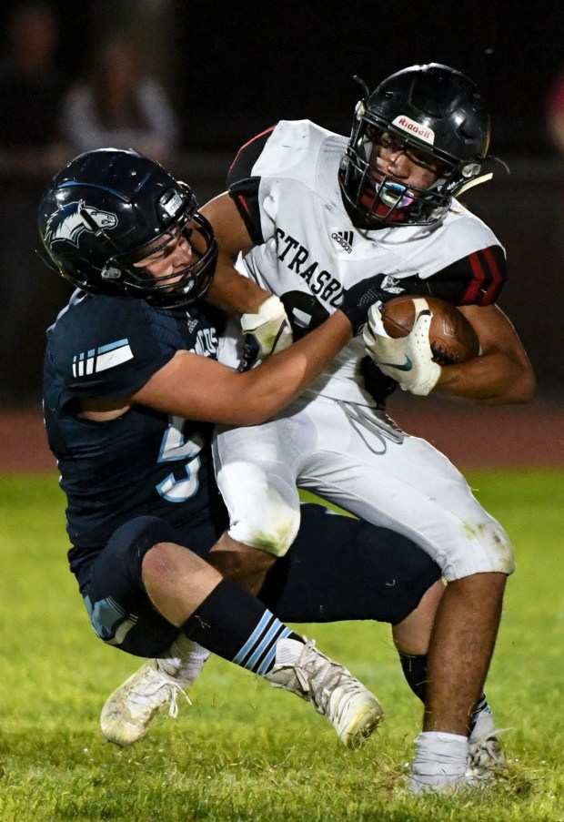 KERSEY, CO - AUGUST 27:Platte Valley's Brody White (57) takes down Strasburg's Zach Marrero (8) during the Platte Valley Broncos football game against the Strasburg Indians at Platte Valley High School in Kersey Aug. 27, 2021. The Broncos defeated the Indians 18-7. (Alex McIntyre/Staff Photographer)