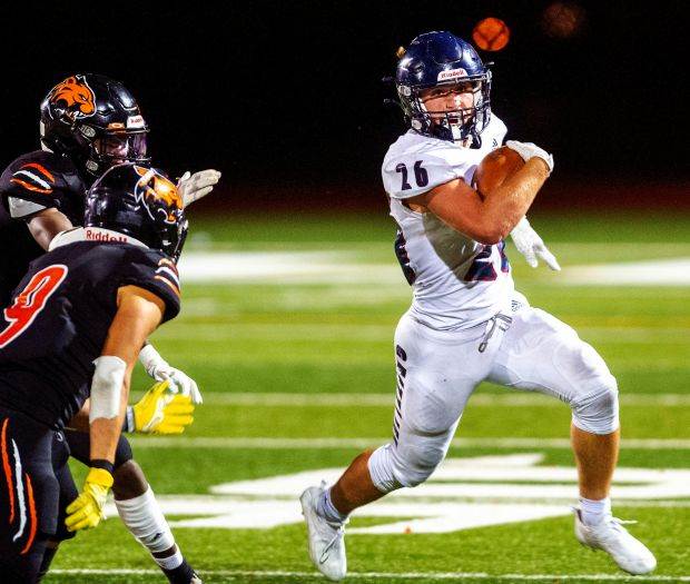 Northridge's Isaac Kness, right, runs for extra yardage while playing Greeley Central at District 6 Stadium on Friday night. (Jim Rydbom/For Greeley Tribune)