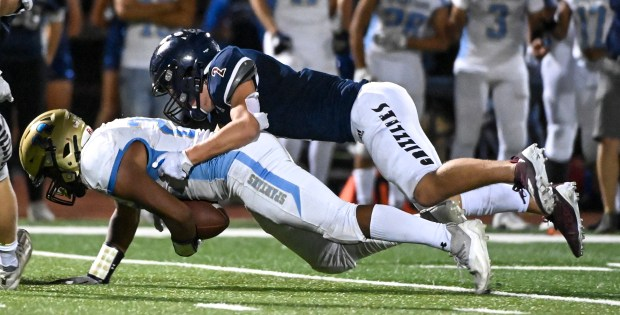 GREELEY, CO - SEPTEMBER 10:Northridge's Brendan Peterson (2) brings down Greeley West's David Lopez (22) during the Northridge Grizzlies crosstown rivalry football game against the Greeley West Spartans at District 6 Stadium in Greeley Sept. 10, 2021. The Grizzlies dropped the Spartans 21-7. (Alex McIntyre/Staff Photographer)