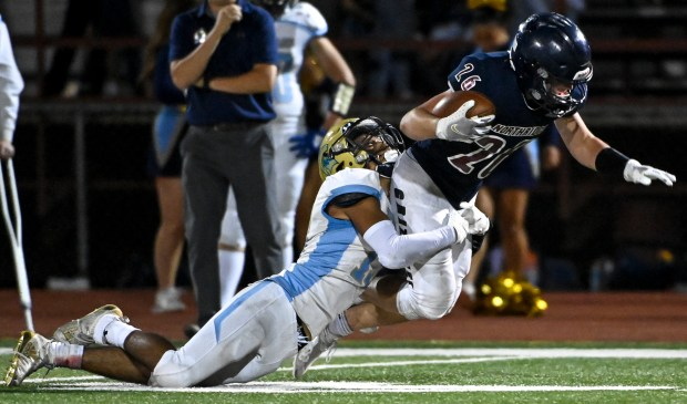 GREELEY, CO - SEPTEMBER 10:Greeley West's Jose Salas (13) brings down Northridge's Isaac Kness (26) during the Northridge Grizzlies crosstown rivalry football game against the Greeley West Spartans at District 6 Stadium in Greeley Sept. 10, 2021. The Grizzlies dropped the Spartans 21-7. (Alex McIntyre/Staff Photographer)