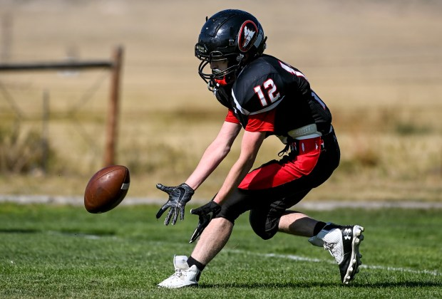 GROVER, CO - SEPTEMBER 17:Pawnee's Hunter Newlon (12) grabs the ball on a kick return during the Pawnee Coyotes 1A 6-man football game against the Fleming Wildcats at Pawnee High School in Grover Sept. 17, 2021. The Pawnee Coyotes fell to the Fleming Wildcats 70-0. (Alex McIntyre/Staff Photographer)