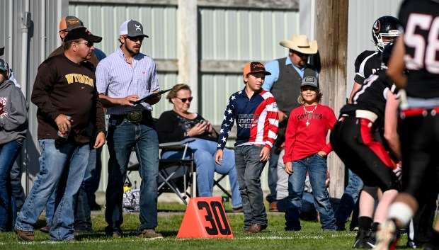 GROVER, CO - SEPTEMBER 17:Pawnee fans watch from the sidelines during the Pawnee Coyotes 1A 6-man football game against the Fleming Wildcats at Pawnee High School in Grover Sept. 17, 2021. The Pawnee Coyotes fell to the Fleming Wildcats 70-0. (Alex McIntyre/Staff Photographer)