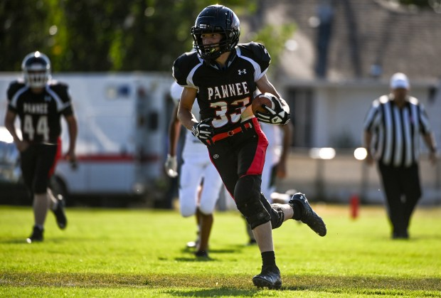 GROVER, CO - SEPTEMBER 17:Pawnee's Kaeden Gebauer (33) runs downfield after making a catch during the Pawnee Coyotes 1A 6-man football game against the Fleming Wildcats at Pawnee High School in Grover Sept. 17, 2021. The Pawnee Coyotes fell to the Fleming Wildcats 70-0. (Alex McIntyre/Staff Photographer)