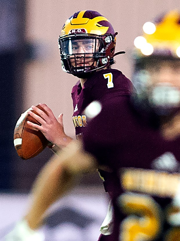 Windsor's quarterback Garrett Sauer looks to pass the ball while playing Bear Creek in Windsor on Friday night. (Jim Rydbom/For the Greeley Tribune)