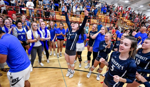 EATON, CO - SEPTEMBER 28:The Bulldogs and University High School students celebrate after the University Bulldogs won their volleyball match against the Eaton Reds at Eaton High School in Eaton Sept. 28, 2021. The University Bulldogs defeated the Eaton Reds 3-1. (Alex McIntyre/Staff Photographer)