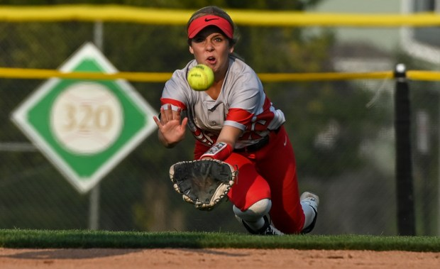 GREELEY, CO - SEPTEMBER 07:Eaton's Emma Pinkstaff (17) dives to catch University's Kaitlynn Baca (6)'s fly ball for an out during the University Bulldogs softball game against the Eaton Reds at Twin Rivers Ballparks in Greeley Sept. 7, 2021. The Reds defeated the Bulldogs 6-4. (Alex McIntyre/Staff Photographer)