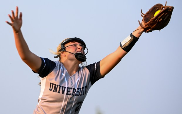 GREELEY, CO - SEPTEMBER 07:University's Ashlyn Knapp (22) stretches to catch a fly ball during the University Bulldogs softball game against the Eaton Reds at Twin Rivers Ballparks in Greeley Sept. 7, 2021. The Reds defeated the Bulldogs 6-4. (Alex McIntyre/Staff Photographer)