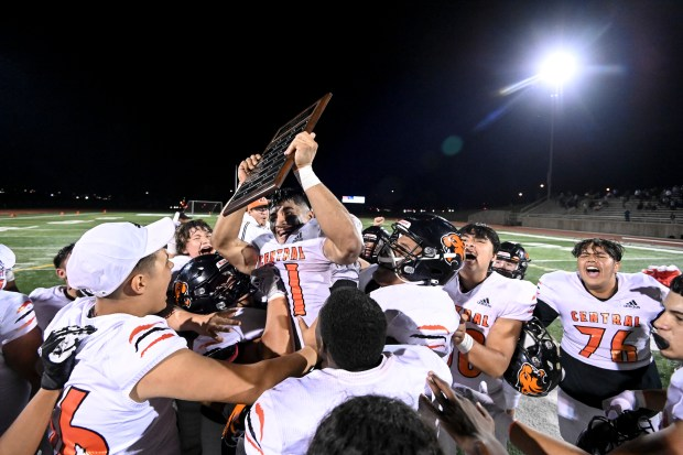 GREELEY, CO - SEPTEMBER 24:The Greeley Central Wildcats lift their MVP Yahir Chairez-Salazar (31) in celebration after the Greeley Central Wildcats crosstown rivalry football game against the Greeley West Spartans at District 6 Stadium in Greeley Sept. 24, 2021. The Wildcats defeated the Spartans 32-13. (Alex McIntyre/Staff Photographer)