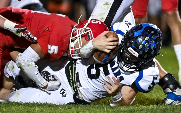 EATON, CO - OCTOBER 09:Eaton's Ethan Florez (5) brings down Resurrection Christian's Cade Dunlap (5) during the Eaton Reds football game against the Resurrection Christian Cougars at Eaton High School in Eaton Oct. 9, 2021. The Reds defeated the Cougars 10-6. (Alex McIntyre/Staff Photographer)