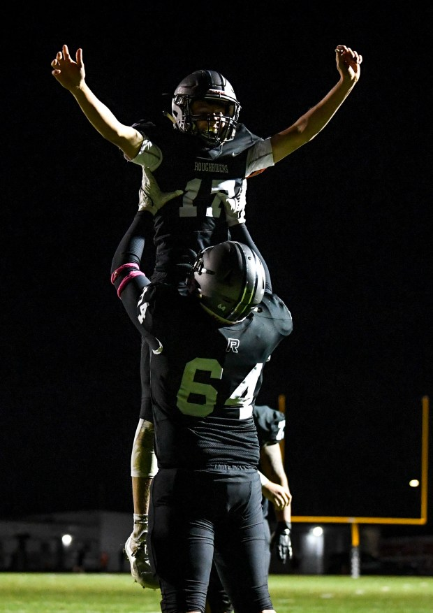 JOHNSTOWN, CO - OCTOBER 08:Roosevelt's Austin Schultz (64) lifts Roosevelt's Brock Saya (17) to celebrate Saya's touchdown during the Roosevelt Roughriders football game against the Mead Mavericks at Roosevelt High School in Johnstown Oct. 8, 2021. The Roughriders defeated the Mavericks 37-7. (Alex McIntyre/Staff Photographer)