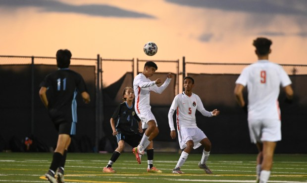 GREELEY, CO - OCTOBER 06:A Greeley Central player heads the ball during the Greeley Central Wildcats crosstown rivalry boys soccer match against the Greeley West Spartans at District 6 Soccer Stadium in Greeley Oct. 6, 2021. The Wildcats defeated the Spartans 1-0. (Alex McIntyre/Staff Photographer)
