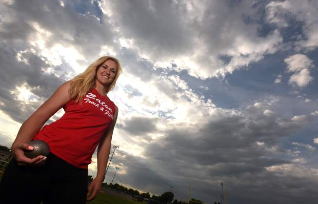 Tarynn Sieg poses with her shot put nearby the Eaton track on Wednesday in Eaton.