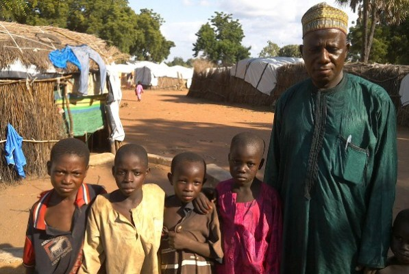 Ozi Usman with Malkohi children