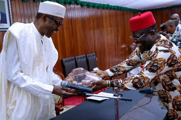 President Muhammadu Buhari receiving gift from Ebony state Governor, Martin Elechi