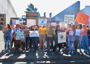 youth holding climate protest signs