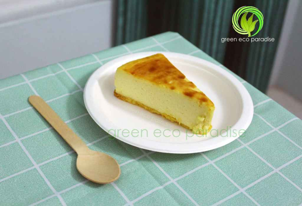 Wooden spoon with a slice of cake