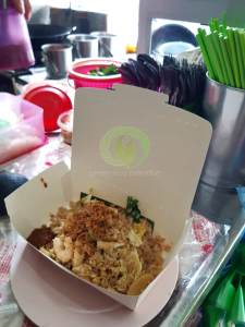 Fried rice served in lunch box with banana leaf