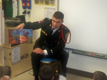 Male volunteers encourage reading at Headstart