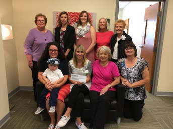 Presentation of Women Of Worth grant awards, Back row, L-R: Mary Lou Quiel, WOW; Crystal Plano, Corianne Vanderkolk, & Linda Bedwell, Greene County Health; Linda Haseman, WOW; front row, L-R: Cara and Aedan Gambill & Megan Crowe, Greene County Health; Carolyn Crichfield & Sheila Corey, WOW