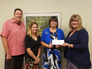 Presentation of Board Of Realtors grant award, L-R: Mark Bush, Lisa Abbott, Sheila Corey of Open Arms, Lisa Funkhouser