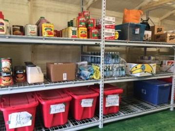 Storage shelves of food for the hungry, in use at Son Ministries' Summer Food Service Program