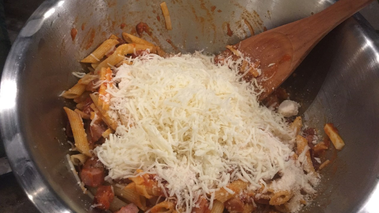 Adding Parmesan & more cheese