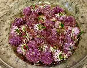Chive blossoms mixed with vinegar