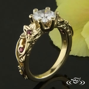 CUSTOM FLORAL MOUNTING IN 18K YELLOW GOLD WITH RUBY ACCENTS.