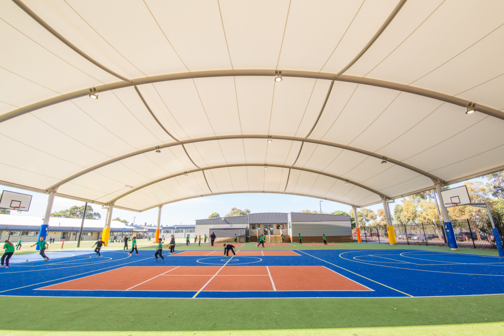Permanent shade structure for sports courts