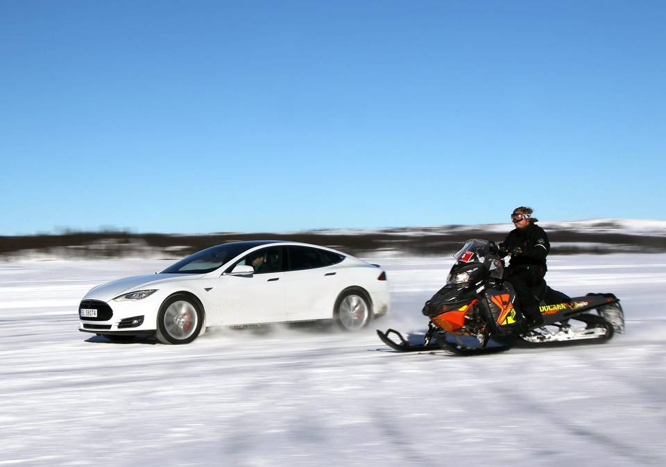 Tesla Model S P85D vs Snowmobile Drag Race on Ice - The