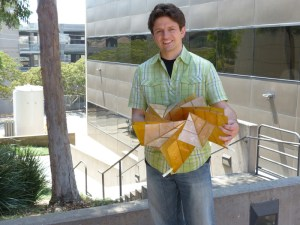 Brian Trease with the origami solar panel