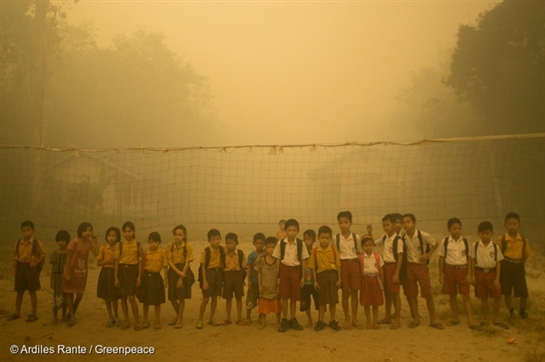 Children play without wearing any protection at the playground while the air is engulfed with thick haze from the forest fires at Sei Ahass village, Kapuas district in Central Kalimantan province on Borneo island, Indonesia.