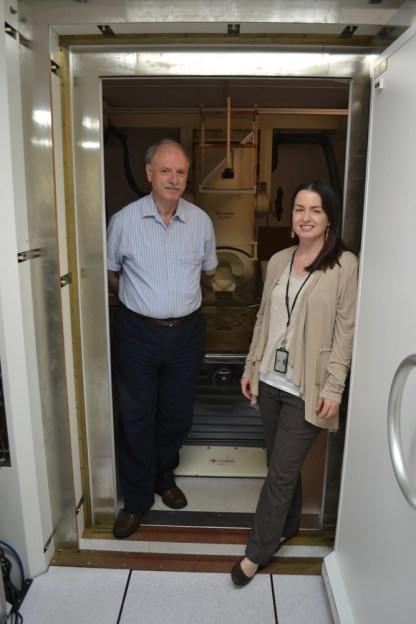 Apostolos Georgopoulos and Maggie Mahan in doorway of magnetoencephalography room