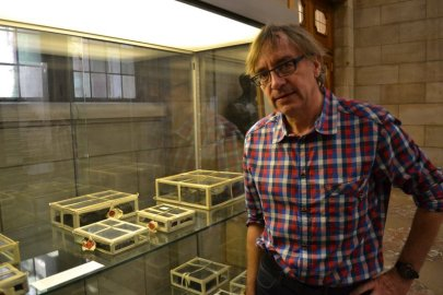 Mark Deretz, Leuven University archivist, beside carbonized remains of old library.